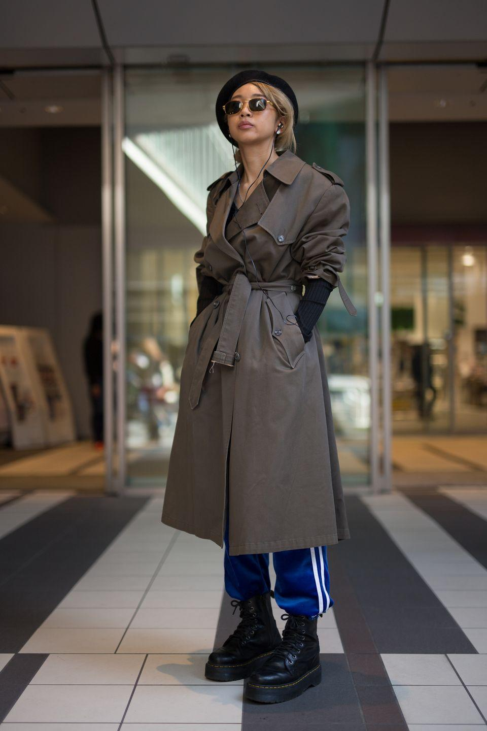 """<p>Give your go-to track pants an instant refresh by styling them with a well-tailored trench coat and trendy flat-form boots. </p><p><strong>Get the look: Tory Burch</strong> Geo-T wide-leg track pants, $158, <a href=""""https://go.skimresources.com?id=74968X1525079&xs=1&url=https%3A%2F%2Fwww.toryburch.com%2Fgeo-t-wide-leg-track-pants%2F59819.html%3Fcolor%3D359%26size%3DS%26utm_source%3Dgoogle%26utm_medium%3Dcpc%26adpos%3D%26scid%3Dscplp192485387544%26sc_intid%3D192485387544%26gclid%3DCj0KCQjwreT8BRDTARIsAJLI0KJhb-Ol5Ul5K4UhyKmvz6RyYXvuALdw5T6vZL8_ZDwMuyZ08s6fiscaAuHaEALw_wcB%26gclsrc%3Daw.ds"""" rel=""""nofollow noopener"""" target=""""_blank"""" data-ylk=""""slk:toryburch.com"""" class=""""link rapid-noclick-resp"""">toryburch.com</a>.</p>"""