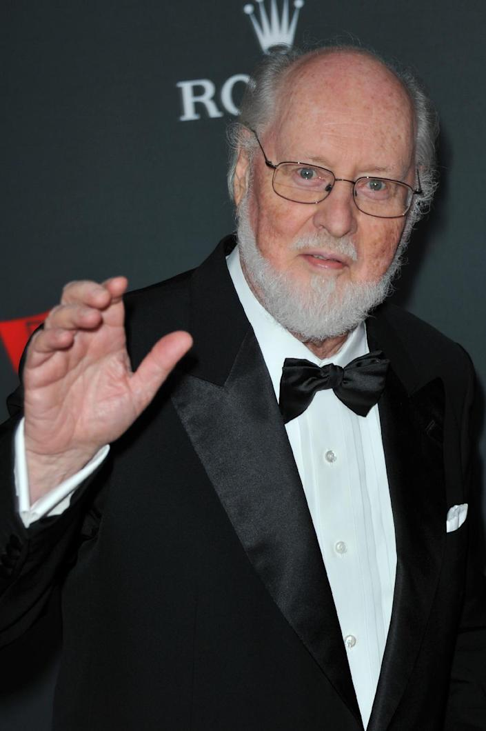 """FILE - In this Sept. 27, 2012 file photo, composer John Williams arrives at the Los Angeles Philharmonic's 2012 Opening Night Gala, in Los Angeles. The film academy announced Thursday, Feb. 13, 2014, it plans to present a live Oscar Concert celebrating the year's nominated composers, including Williams for """"The Book Thief."""" Besides music from """"Gravity,"""" """"The Book Thief,"""" """"Saving Mr. Banks,"""" """"Philomena"""" and """"Her,"""" the program will include performances of the four original songs up for Oscars this year. (Photo by Richard Shotwell/Invision/AP, file)"""