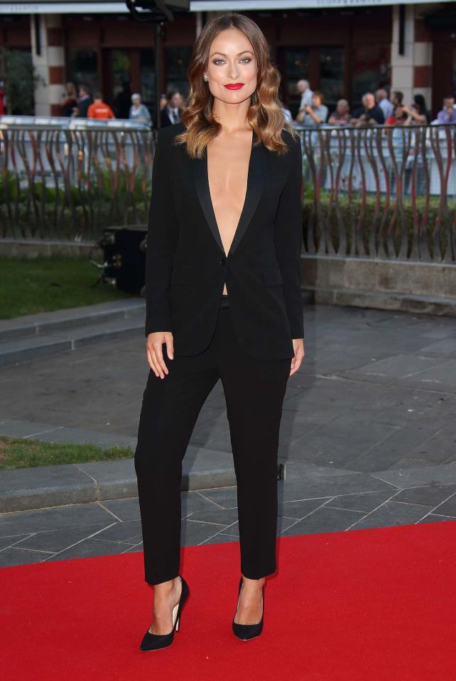 Olivia Wilde: Hello, ladies! We're guessing it took several rolls of double-sided tape to make this custom Gucci tuxedo work without a wardrobe malfunction, but the results were certainly worth it. (9/2/13) Credit: Mike Marsland/WireImage