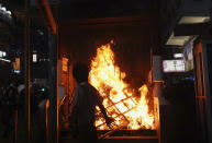 "The entrance to a subway station is set on fire during a protest in Hong Kong on Sunday, Oct. 27, 2019. Hong Kong police fired tear gas Sunday to disperse a rally called over concerns about police conduct in monthslong pro-democracy demonstrations, with protesters cursing the officers and calling them ""gangster cops."" (AP Photo/Vincent Yu)"