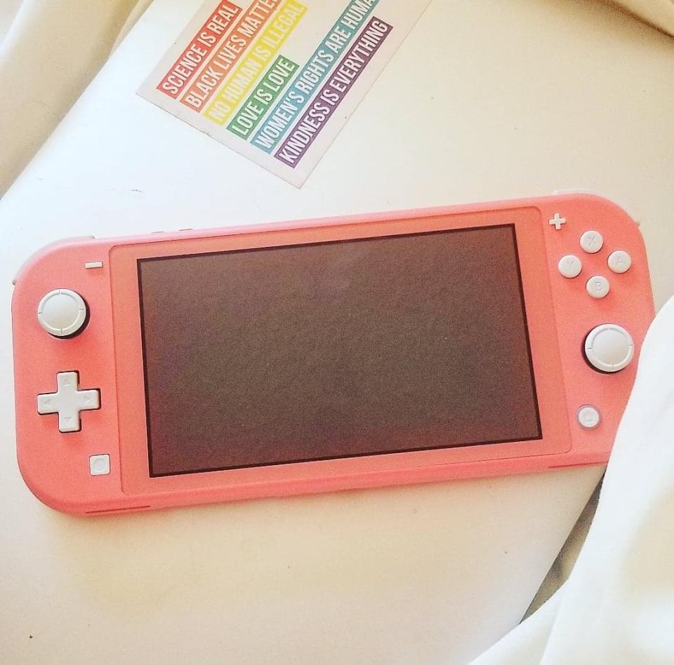 Nintendo Switch Lite in Coral. Image via Sarah Rohoman