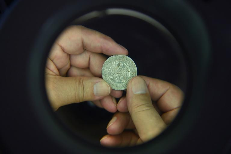 The coins' discovery has thrown up more questions than answers -- historians are in the dark about the owner's identity and how the collection was amassed (AFP Photo/ATTILA KISBENEDEK)