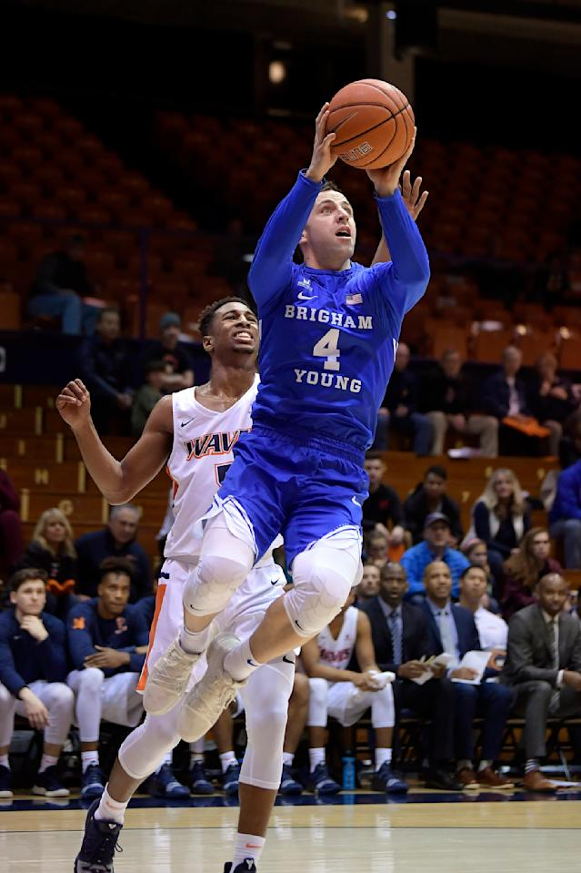 FILE - In this Jan. 17, 2019, file photo, BYU guard Nick Emery, right, shoots as Pepperdine guard Jade' Smith defends during the first half of an NCAA college basketball game, in Malibu, Calif. BYU guard Nick Emery said Tuesday, July 23, 2019, he is retiring from basketball following a college career that began with high expectations but that ended with him at the center of an NCAA investigation. Emery used social media to announce he is stepping away with a year of eligibility still remaining.(AP Photo/Mark J. Terrill, File)