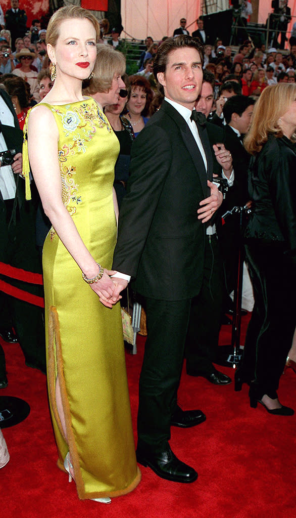 <p>The A-list couple hit the red carpet for Cruise's second Oscar nomination for his role in 'Jerry Maguire.' (Photo: Frank Trapper/Getty Images) </p>
