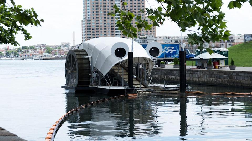 Mr. Trash Wheel, the mostly autonomous trash interceptor, cleaning up trash from a river in Baltimore.