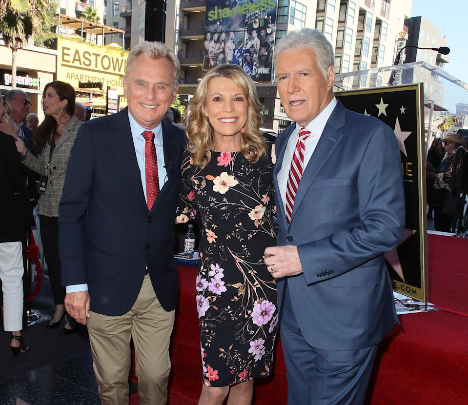 HOLLYWOOD, CALIFORNIA - NOVEMBER 01: (L-R) Pat Sajak, Vanna White and Alex Trebek attend Harry Friedman being honored with a Star on the Hollywood Walk of Fame on November 01, 2019 in Hollywood, California. (Photo by David Livingston/Getty Images)