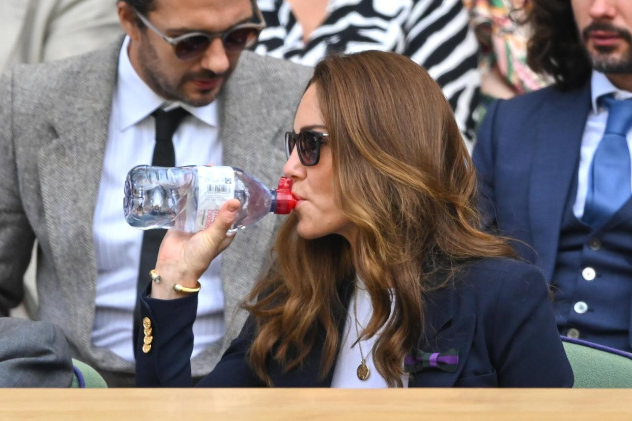 LONDON, ENGLAND - JULY 02: Catherine, Duchess of Cambridge takes a drink from a water bottle during the Wimbledon Championships Tennis Tournament at All England Lawn Tennis and Croquet Club on July 02, 2021 in London, England. (Photo by Karwai Tang/WireImage)