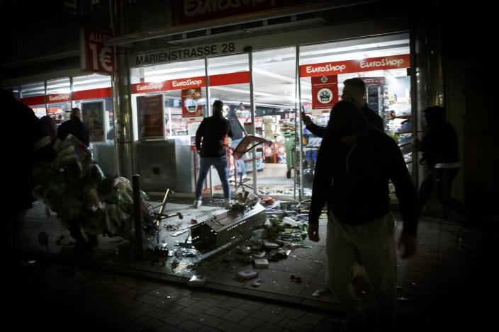 Goods lie on the floor after people broke into a shop on Marienstrasse in Stuttgart, Germany, Sunday, June 21, 2020. Dozens of violent small groups devastated downtown Stuttgart on Sunday night and injured several police officers, German news agency DPA reported. (Julian Rettig/dpa via AP)