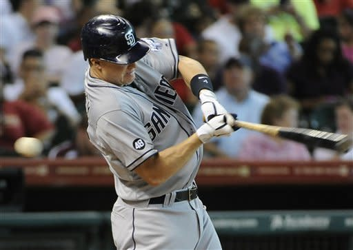 San Diego Padres' Nick Hundley swings for a strike on his way to striking out against the Houston Astros in the third inning of a baseball game Wednesday, June 27, 2012, in Houston. (AP Photo/Pat Sullivan)