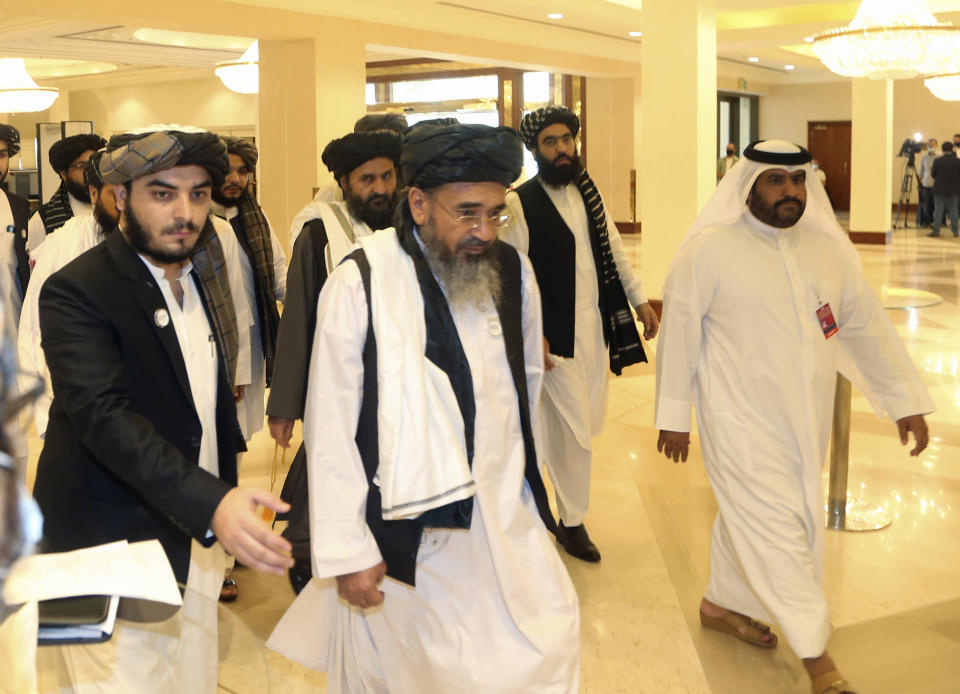 FILE - In this Sept. 12, 2020 photo, a Taliban delegation arrive to attend the opening session of the peace talks between the Afghan government and the Taliban in Doha, Qatar. On Jan. 31, 2021, Rasul Talib, a member of the Afghan government's peace negotiating team warned the Taliban that if they don't resume peace talks in Qatar soon, the government could recall the team before a deal is reached. Talib said in a press conference the team is waiting for the return of the Taliban leadership to Doha, Qatar, where a second round of peace talks began this month but has made little progress. (AP Photo/ Hussein Sayed, File)