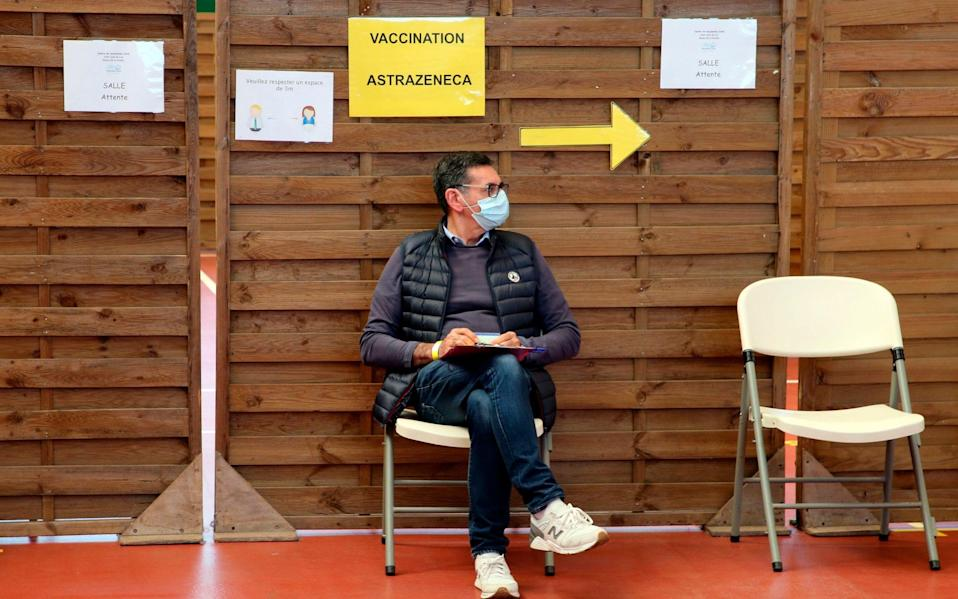 A man waits to get vaccinated with the AstraZeneca jabin a vaccination center of Saint-Jean-de-Luz, southwestern France - Bob Edme/AP