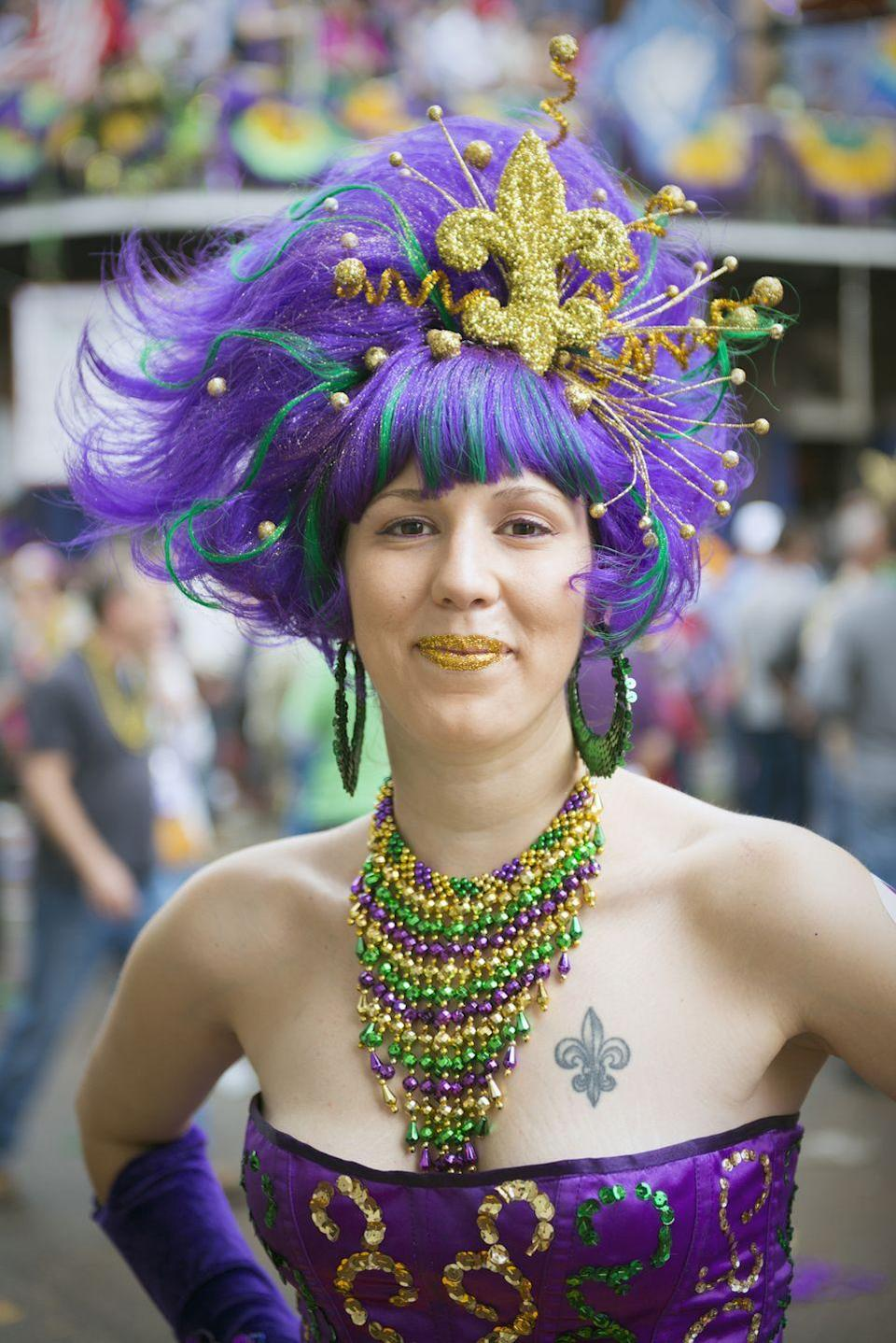 """<p>You'll see the French Quarter festooned with these official colors of Mardi Gras every year. Originally the hues of the Krewe of Rex (aka <a href=""""https://www.rexorganization.com/Tradition"""" rel=""""nofollow noopener"""" target=""""_blank"""" data-ylk=""""slk:the Rex Organization"""" class=""""link rapid-noclick-resp"""">the Rex Organization</a>, aka the School of Design), a New Orleans krewe founded in 1872, they've since become the palette of Carnival citywide. Each color is recognized to have <a href=""""https://www.mardigrasneworleans.com/history/traditions/colors"""" rel=""""nofollow noopener"""" target=""""_blank"""" data-ylk=""""slk:its own meaning"""" class=""""link rapid-noclick-resp"""">its own meaning</a>: Purple for justice, green for faith, and gold for power.</p>"""