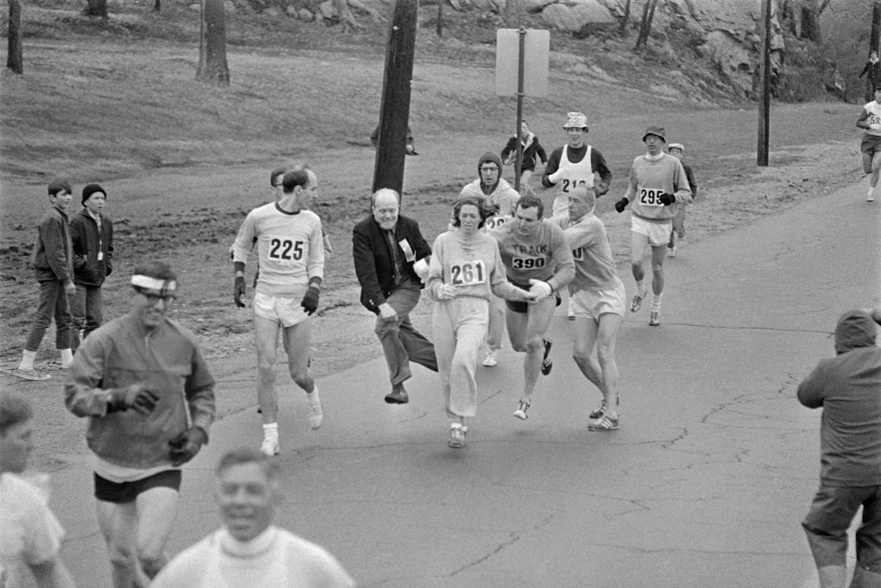In the Boston Marathon, one of two women running in the normally all-male-race, Kathy Switzer, (261) of Syracuse, New York, is being hassled by BAA Marathon Director Bill Cloney, as he attempted to stop her from competing on April 19, 1967. The dark-haired girl did not show up for the physical examination required of all starters, (had she appeared at the starting line, she would never have been allowed to compete). she remained in the race, but was never seen near the finish line.