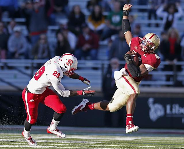 Boston College running back Andre Williams (44) tries to evade North Carolina State cornerback Jack Tocho (29) in the third quarter of an NCAA college football game in Boston, Saturday, Nov. 16, 2013. Boston College won 38-21. (AP Photo/Michael Dwyer)