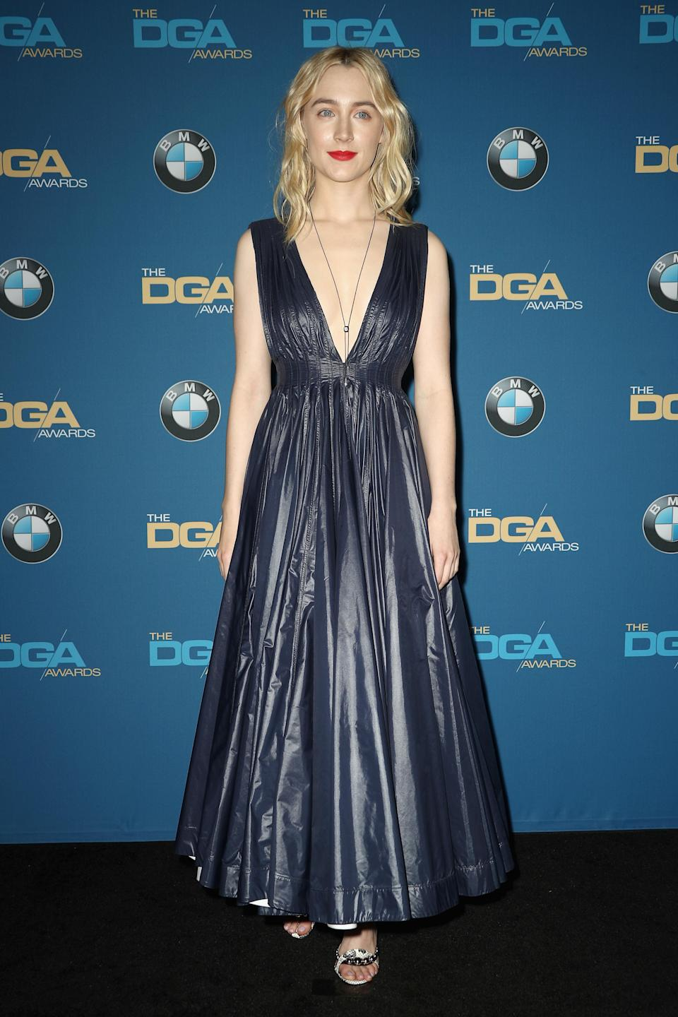 <p>Saoirse paired a Calvin Klein dress with a pair of Louboutin heels. <em>[Photo: Getty]</em> </p>