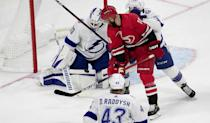 Tampa Bay goalie Maxime Lagace (33) deflects a shot by Carolina Hurricanes' Vincent Trocheck (16) during the first period of their NHL exhibition game on Tuesday, September 28, 2021 at PNC Arena in Raleigh, N.C.