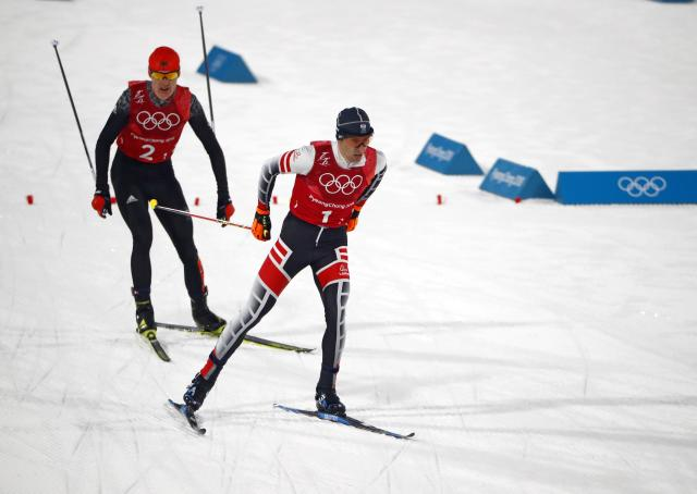 Nordic Combined Events - Pyeongchang 2018 Winter Olympics - Men's Team 4 x 5 km Final - Alpensia Cross-Country Skiing Centre - Pyeongchang, South Korea - February 22, 2018 - Wilhelm Denifl of Austria and Vinzenz Geiger of Germany compete. REUTERS/Dominic Ebenbichler