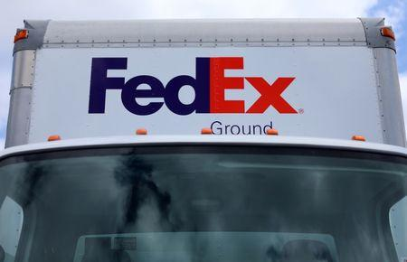 A Federal Express truck is shown on deliver in La Jola