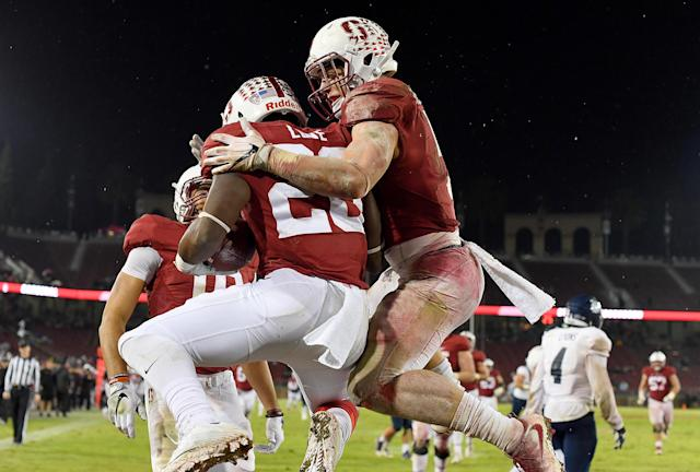Bryce Love (20) and Christian McCaffrey celebrate after Love scored on a 50-yard touchdown run against Rice in 2016. (Getty Images)