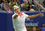 Roger Federer of Switzerland chases down a forehand to Novak Djokovic of Serbia during their men's singles final match at the U.S. Open Championships tennis tournament in New York, September 13, 2015. REUTERS/Mike Segar