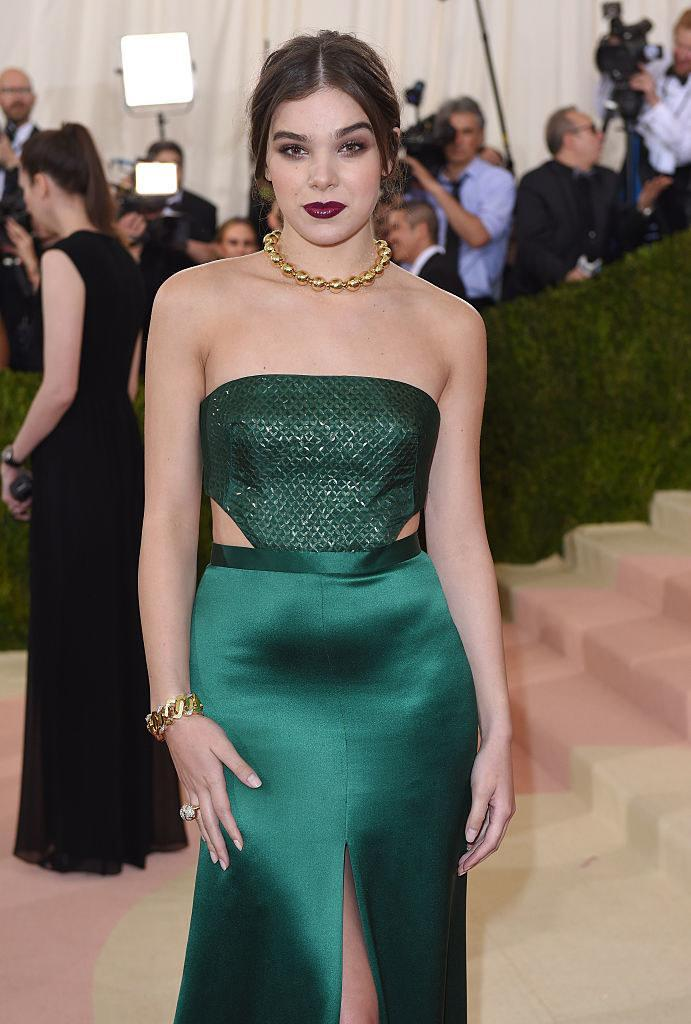 Hailee wore a strapless satin gem-colored gown with a textured bodice