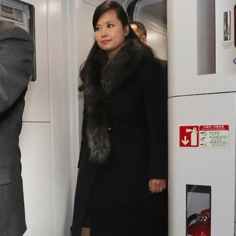 North Korean Hyon Song-wol walks onto a train at the Seoul Train Station in Seoul - Credit: AP