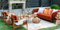 <p>A dose of velvet never fails to add warmth to a room. To celebrate the fall season, go for an orange velvet accent, like a throw pillow or a curved sofa, which can be the highlight of your space year-round. </p>
