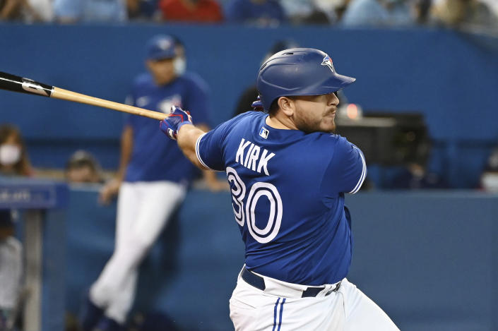 Toronto Blue Jays' Alejandro Kirk hits a single in the fourth inning of a baseball game against the Tampa Bay Rays in Toronto on Monday, Sept. 13, 2021. (Jon Blacker/The Canadian Press via AP)