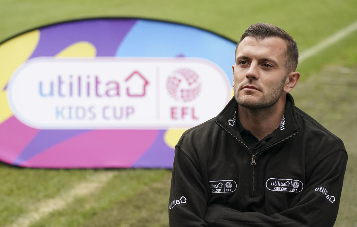 On the pitch at The Valley, home of Charlton Athletic, former Arsenal FC player Jack Wilshere, and former Birmingham, Chelsea and England player Karen Carney help to launch the Utilita Kids and Girls Cup with the children from Ealdham Primary School.