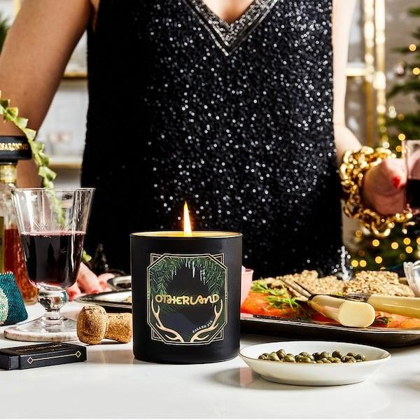 <p>This beautiful <span>Otherland Fallen Fir Vegan Candle</span> ($36) makes for such a great hostess gift.</p>
