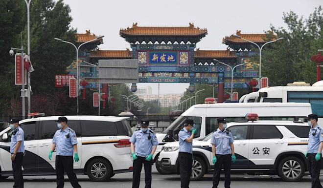 Chinese police guard the entrance to the closed Xinfadi market in Beijing on June 13. It was closed for coronavirus containment measures during an outbreak in the city. Photo: AFP
