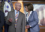"""House Transportation and Infrastructure Committee Chair Peter DeFazio, D-Ore., left, talks to Speaker of the House Nancy Pelosi, D-Calif., during a news conference to discuss the """"INVEST in America Act,"""" a five-year surface transportation bill, which directs federal investments in roads, bridges, transit, and rail, at the Capitol in Washington, Wednesday, June 30, 2021. (AP Photo/J. Scott Applewhite)"""