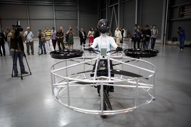 A 'Flying bike' bicycle is seen ahead of its first public flight on June 12, 2013 in Prague, Czech Republic. The bike has been manufactured by 3 different companies from the Czech Republic (Duratec, Technodat, Evektor) and has been supported by French Company Dassault System. The F-Bike has four main motors (10kW) and two stabilization motors (3,5 kW). It has an estimated constant flight time of 3-5 minutes. (Photo by Matej Divizna/Getty Images)