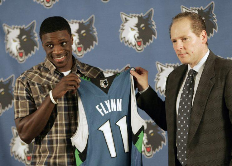 David Kahn poses with Wolves bust Johnny Flynn. (AP)