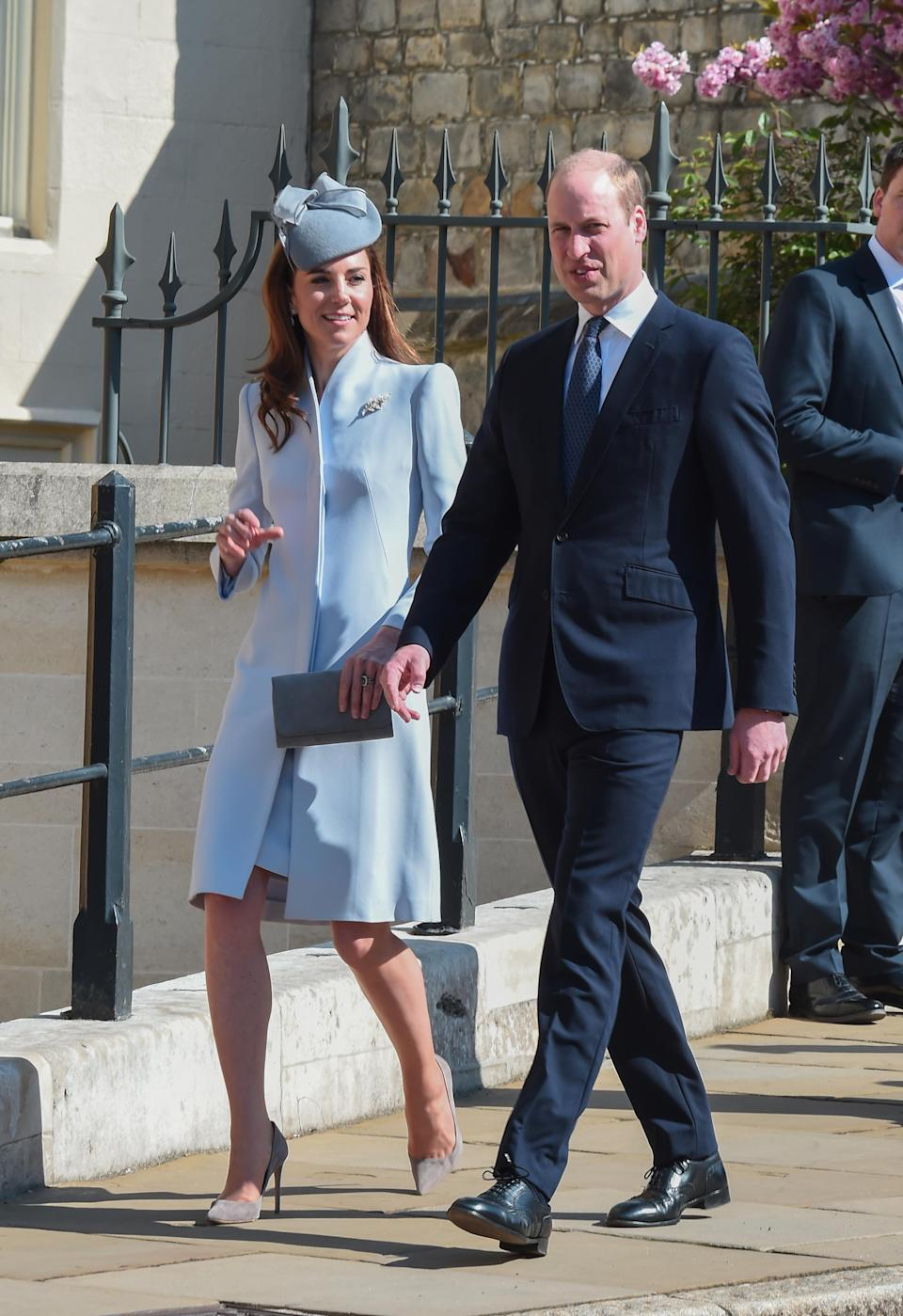 For the Easter Sunday service at St George's Chapel in Windsor, Kate repeated her dove grey Alexander McQueen coat with her Jane Taylor hat from her tour of Australia 2014. Her grey accessories are both by Emmy London. [Photo: PA]