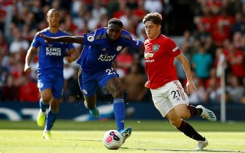 Leicester City's Wilfred Ndidi (left) and Manchester United's Daniel James battle for the ball during the Premier League match at Old Trafford, Manchester. - Credit: PA