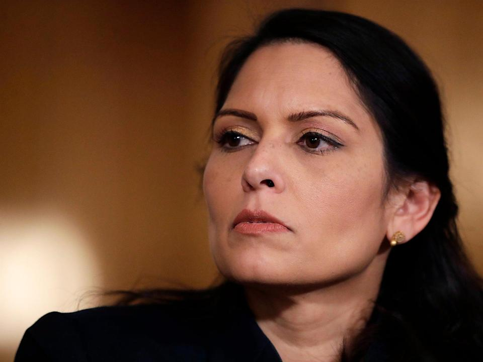 Home secretary Priti Patel is continuing to create a 'hostile environment' to force migrants to leave the UK (AP)