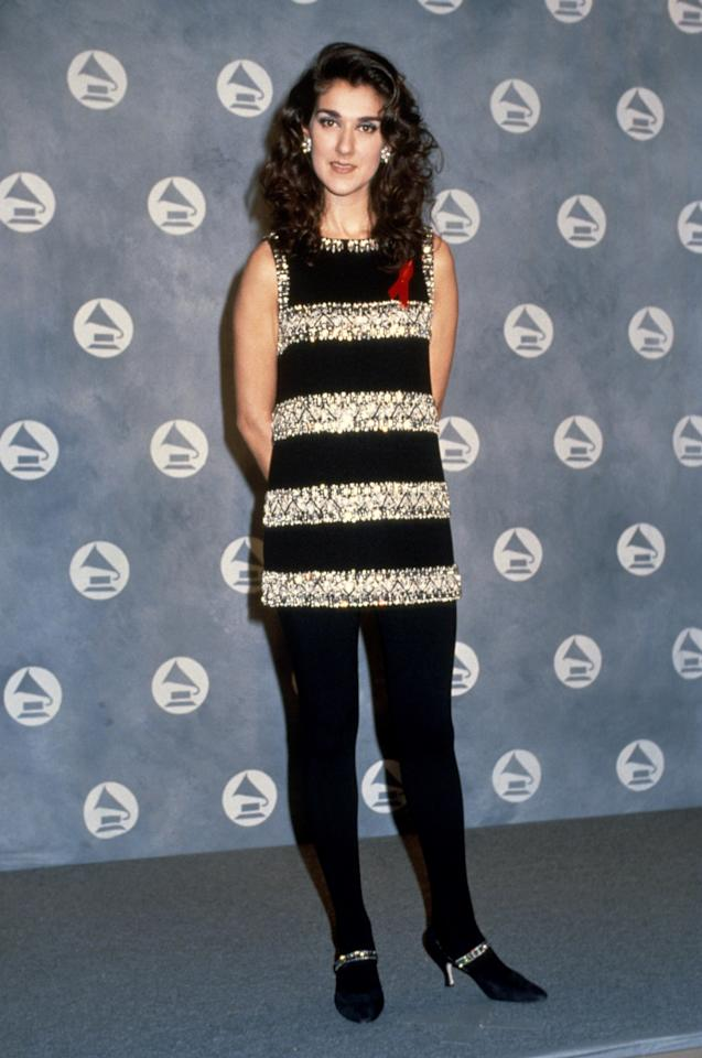 Winning her second Grammy award at the 34th Annual Grammy Awards, the singer wore black pants with an embellished tank dress. 1992. Photo courtesy of Getty Images.
