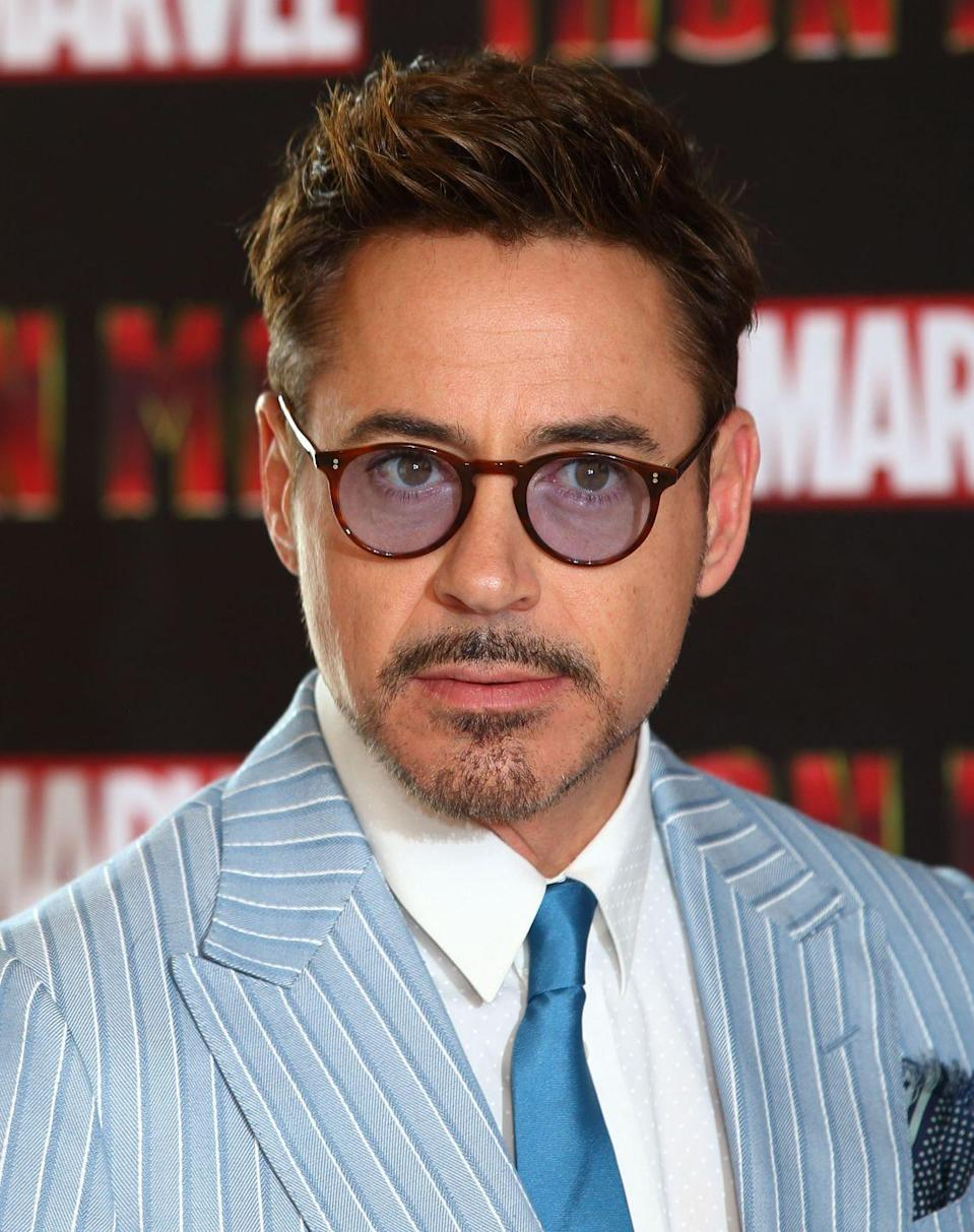 "<p>Downey sported an anchor mustache during the press tour of <em>Iron Man 3 </em>back in 2013. Since then, the actor has toned down his facial hair and showed up to the <a href=""https://www.menshealth.com/style/a27242529/avengers-endgame-red-carpet-style-men-premiere/"" rel=""nofollow noopener"" target=""_blank"" data-ylk=""slk:Avengers: Endgame premiere"" class=""link rapid-noclick-resp""><em>Avengers: Endgame</em> premiere</a> with nothing but scruff.</p>"