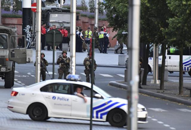 <p>Belgian Army soldiers and police patrol outside Central Station after a reported explosion in Brussels on Tuesday, June 20, 2017. Belgian media are reporting that explosion-like noises have been heard at a Brussels train station, prompting the evacuation of a main square. (AP Photo/Geert Vanden Wijngaert) </p>