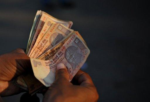 The rupee fell to a low last seen in December before recovering marginally