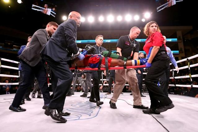 US boxer Patrick Day was in a coma and in critical condition Sunday night, less than 24 hours after undergoing emergency brain surgery as a result of being knocked by Charles Conwell in Chicago (AFP Photo/Dylan Buell)
