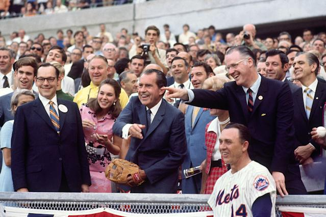 Nixon throws out the first pitch in Cincinnati at the 1970 All-Star Game as commissioner Bowie Kuhn and Mets manager Gil Hodges observe. (Herb Scharfman/Sports Imagery/Getty Images)