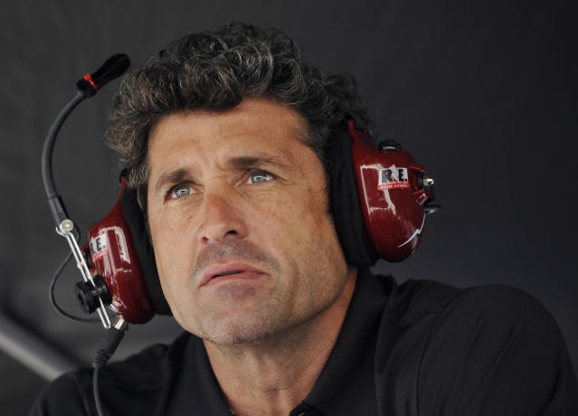 FILE - In this Oct. 18, 2013 file photo, Patrick Dempsey looks on from the pit area during qualifying for the American Le Mans Series' Petit Le Mans auto race at Road Atlanta in Braselton, Ga. Dempsey's love affair with sports-car racing was always more than a frivolous dalliance. He's as dedicated on the track as he is on the set, and placed his sights _ from the eyes of one of People magazine's sexiest men alive _ on contending in the most prestigious road race on the sports car circuit. (AP Photo/Rainier Ehrhardt, File)