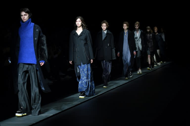 Models present creations from Ujoh by Japanese designer Mitsuru Nishizaki during his 2017 Autumn/Winter Collection show at Tokyo Fashion Week in Tokyo on March 20, 2017