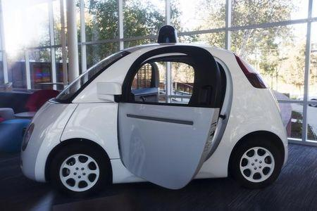 File Photo: A Google self-driving car is seen inside a lobby at the Google headquarters in Mountain View, California November 13, 2015. REUTERS/Stephen Lam