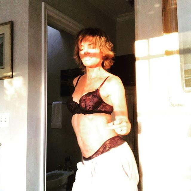 <p>Rinna vibing to Rihanna while wearing Savage X Fenty lingerie is a whole mood. </p>