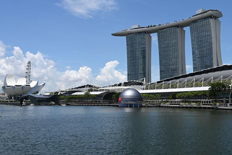 A general view shows the new Apple store (C), located in the water in front of the Marina Bay Sands, in Singapore on August 24, 2020. (Photo by Roslan RAHMAN / AFP) (Photo by ROSLAN RAHMAN/AFP via Getty Images)