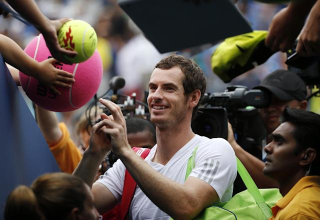 Andy Murray, of the United Kingdom, signs autographs after defeating Andrey Kuznetsov, of Russia, during the third round of the 2014 U.S. Open tennis tournament, Saturday, Aug. 30, 2014, in New York. (AP Photo/Kathy Willens)