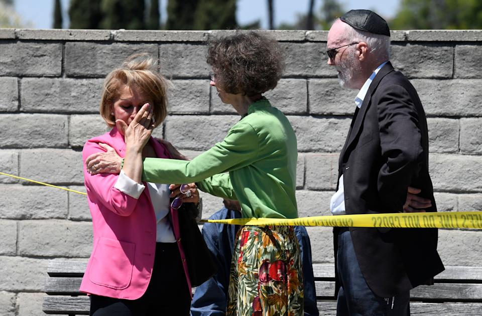 Synagogue members console one another outside of the Chabad of Poway Synagogue in California. Several people were injured in a shooting at the synagogue. Source: AAP